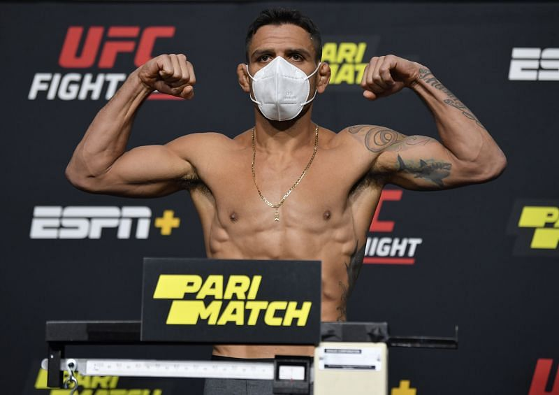 Rafael Dos Anjos of Brazil poses on the scale