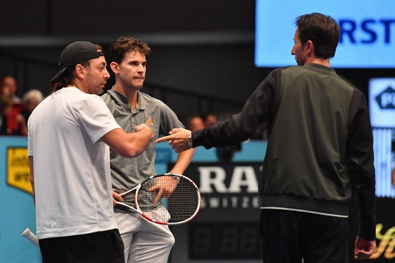 (From left) Nicolas Massu, Dominic Thiem and Wolfgang Thiem chat during a practice session in Vienna