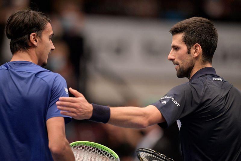 Novak Djokovic (R) and Lorenzo Sonego