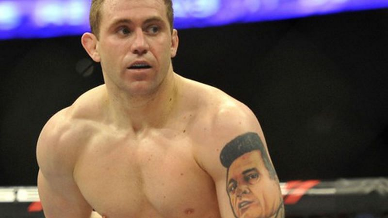 Alan Belcher sported a bizarre tattoo of Johnny Cash on his arm