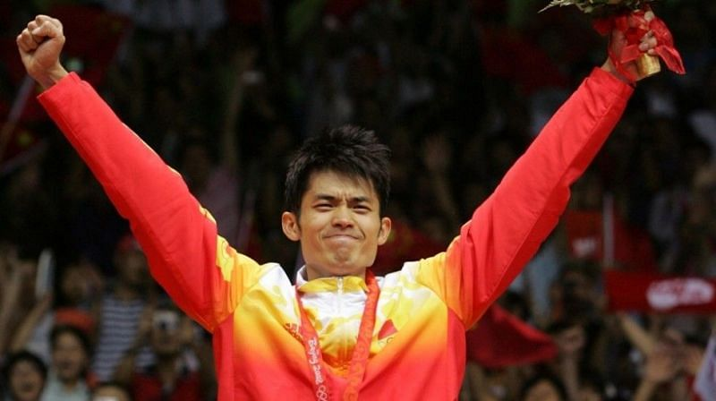Lin Dan celebrates on the podium at the Beijing Olympics in 2008