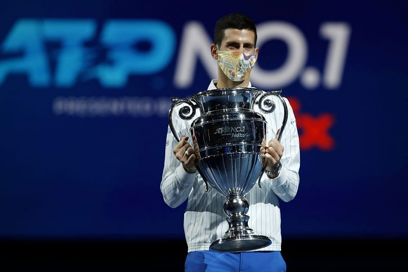 Novak Djokovic celebrates with the year-end World No. 1 trophy