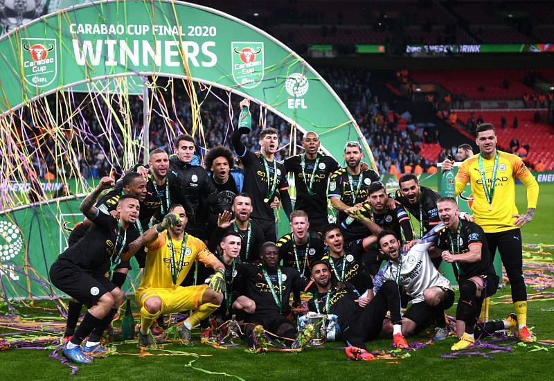 Manchester City players pose with the Carabao Cup