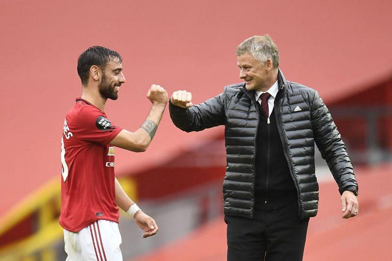 Bruno Fernandes celebrates with Manchester United manager Ole Gunnar Solskjaer