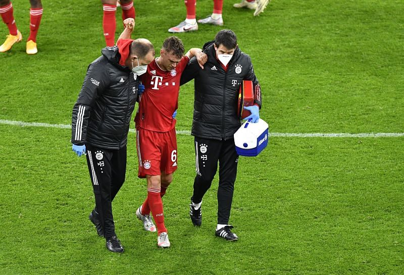 Joshua Kimmich had to be taken off after he injured himself while challenging Erling Haaland