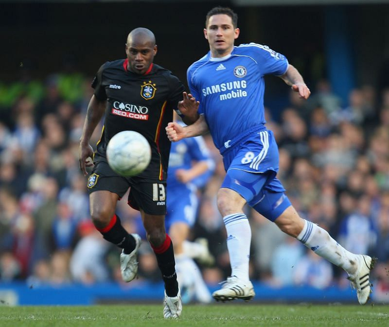 Ex-Chelsea defender Sinclair (L) competing with Frank Lampard