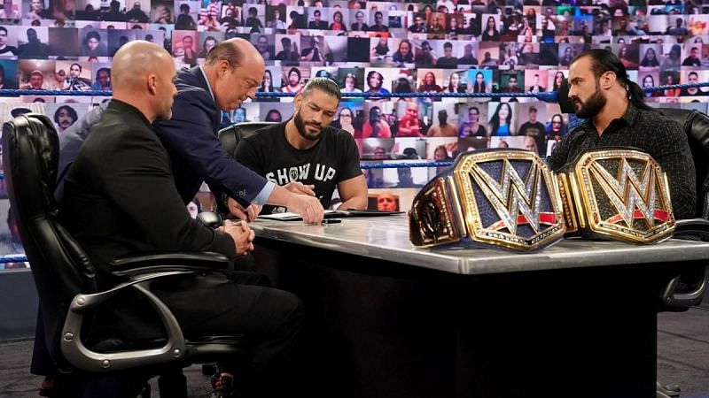 Adam Pearce, Paul Heyman, Roman Reigns and Drew McIntyre