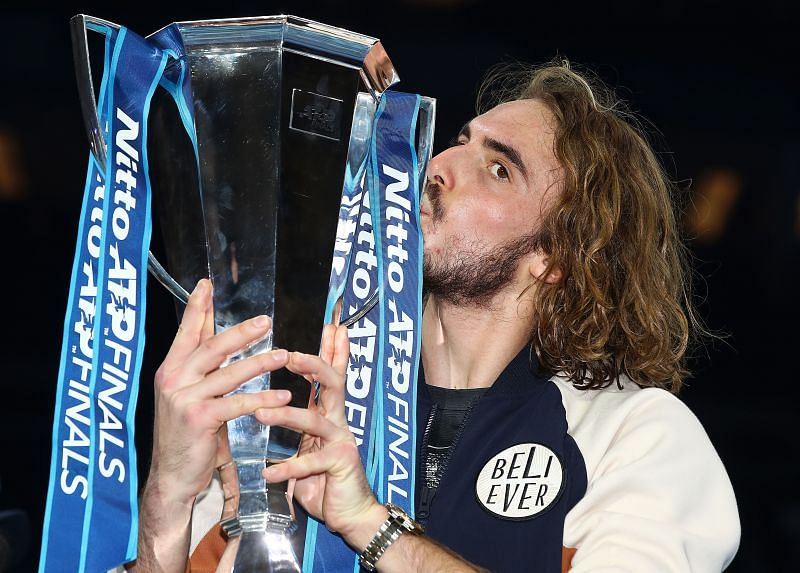 Stefanos Tsitsipas with the Nitto ATP Finals trophy in 2019