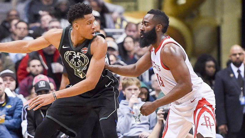 Giannis Antetokounmpo (left) and James Harden (right) battle