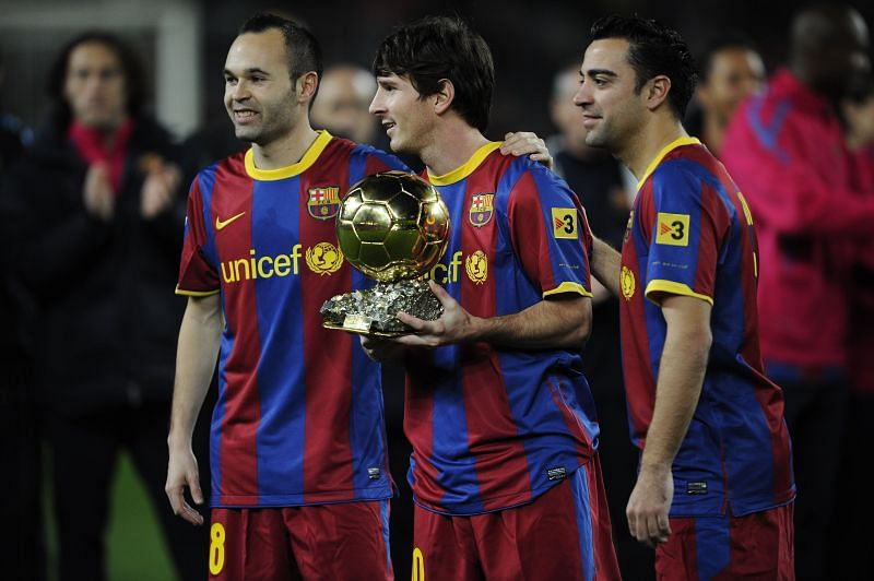 Andres Iniesta (L) and Xavi Hermandez(R) with Leo Messi