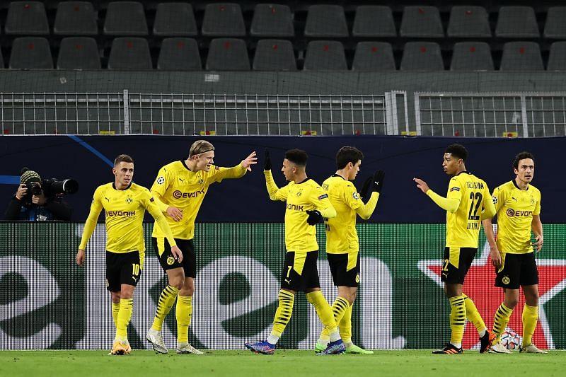 Borussia Dortmund face off against FC Koln in the Bundesliga