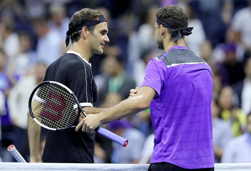 Roger Federer (L) and Grigor Dimitrov at the 2019 US Open
