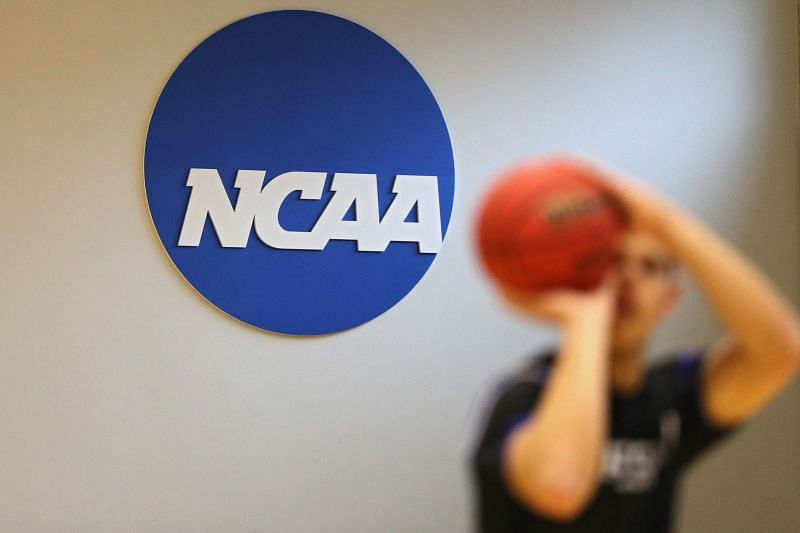 COVID-19 cases cause Johns Hopkins to ban fans at the NCAA Division III basketball tournament.