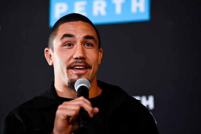 Robert Whittaker takes questions during a UFC 221 media opportunity