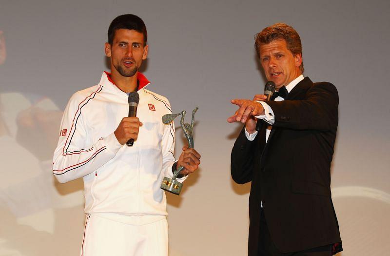 Novak Djokovic receiving the Men
