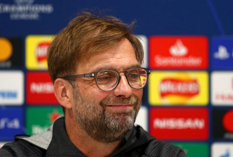 Jurgen Klopp, Manager of Liverpool Kalidou Koulibaly of SSC Napoli ( L ) wins a tackle over Rodrigo Palacio