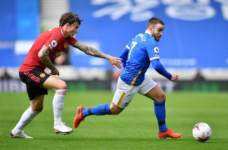 Aaron Connolly of Brighton and Hove Albion is challenged by Victor Lindelof of Manchester United