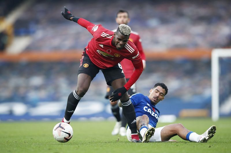 Paul Pogba of Manchester United is challenged by Allan of Everton
