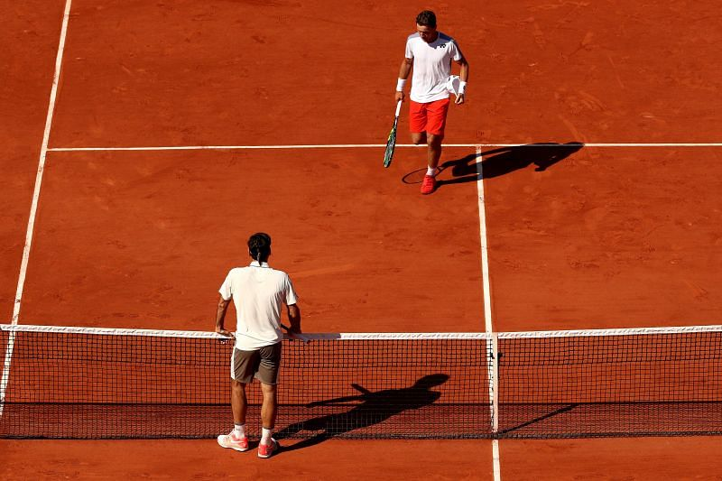 Roger Federer and Casper Ruud at the 2019 French Open