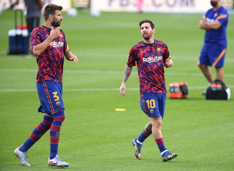 Lionel Messi (right) and Gerard Pique (left)