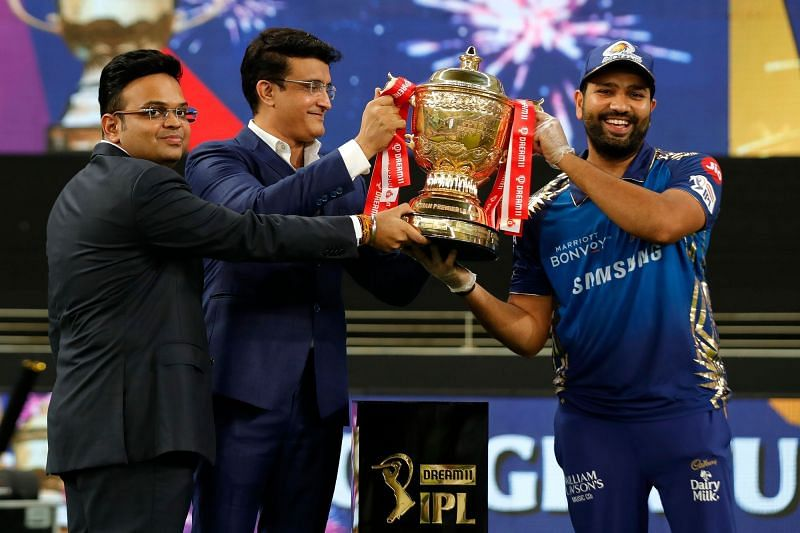 Rohit Sharma (right) receives the IPL 2020 trophy from Sourav Ganguly and Jay Shah (Image credits: timesnownews.com)