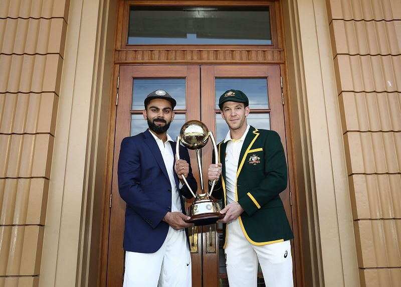 Virat Kohli (L) and Tim Paine (R) with the 2018/19 Border-Gavaskar Trophy