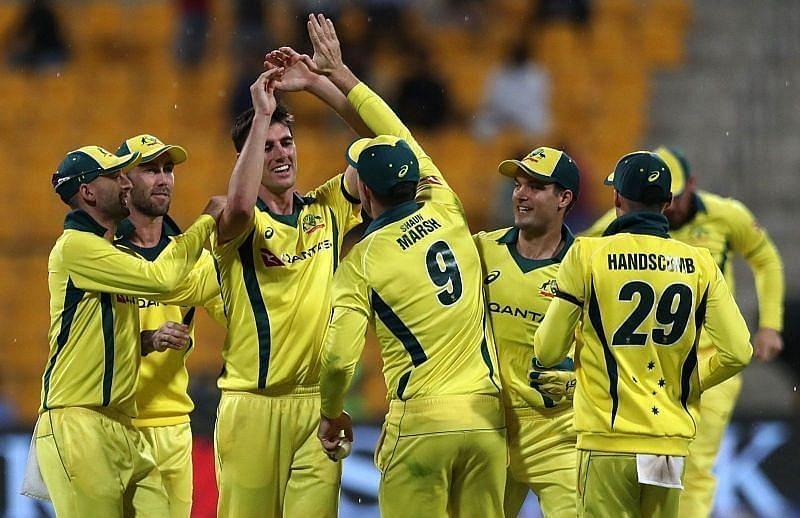 Pat Cummins celebrates a wicket with Australian teammates