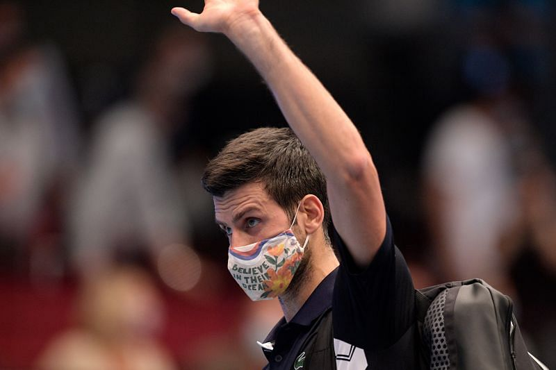 Novak Djokovic leaves the court after losing his quarter-final match to Lorenzo Sonego at Vienna