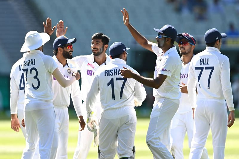 Jasprit Bumrah celebrates with his teammates after dismissing Mitchell Starc in the first innings