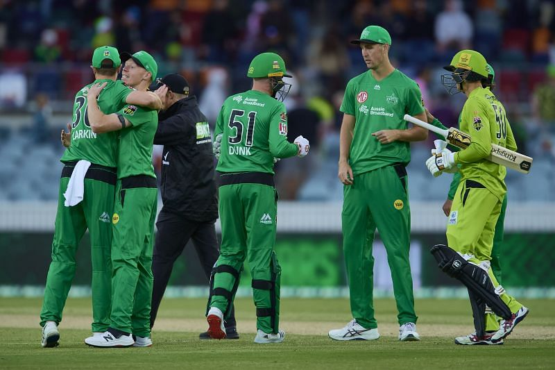 Melbourne Stars players celebrate their victory.