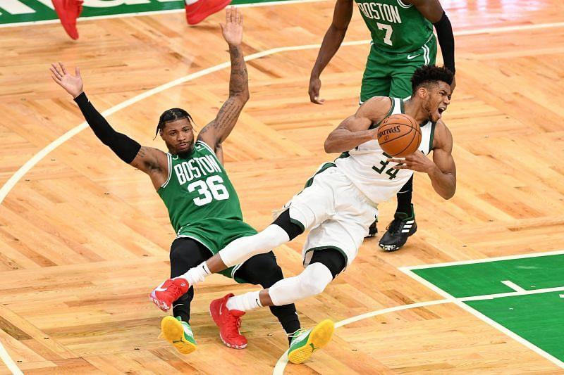 Giannis vies for the ball against Boston Celtics