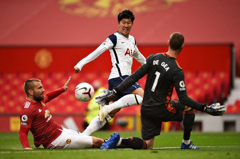 Son dinks the ball past Luke Shaw and David de Gea to score for Spurs
