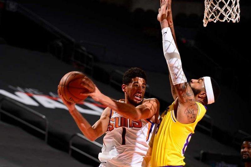 Devin Booker tries to score over Markieff Morris [Image: NBA.com]
