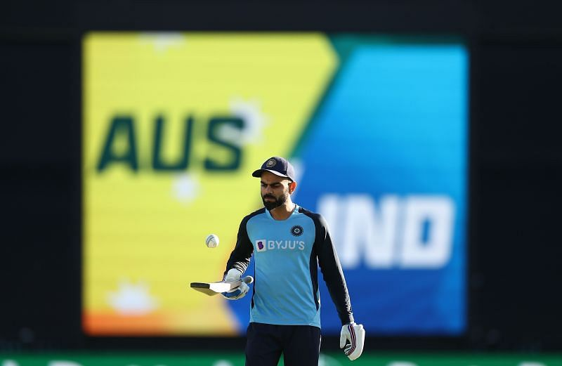 Virat Kohli warms up ahead of the game