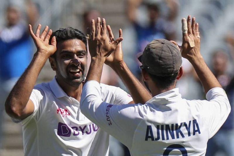 Ravichandran Ashwin celebrates with Ajinkya Rahane after picking up a wicket