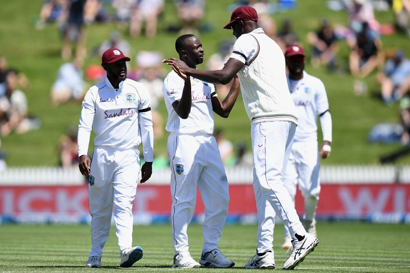 Kemar Roach celebrates a wicket with West Indies teammates