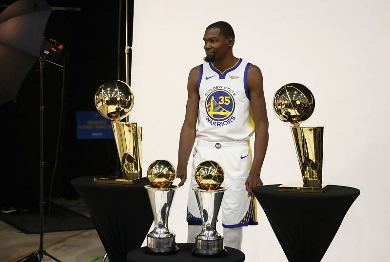 Kevin Durant with his 2 NBA Title trophies and 2 Finals MVP trophies