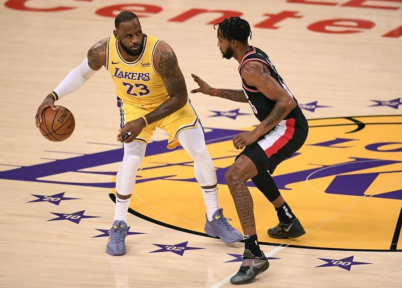 LeBron James guarded by Derrick Jones Jr.