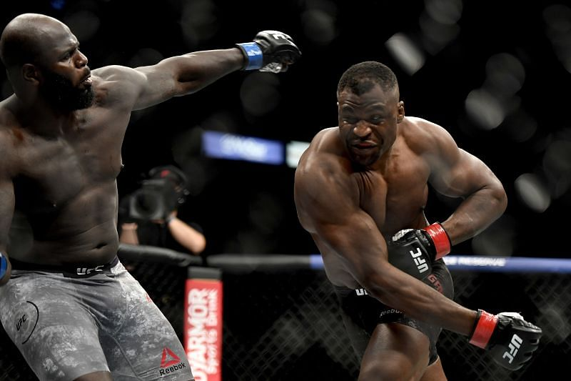Francis Ngannou (R) of Cameroon misses a punch against Jair Rozenstruik of Suriname