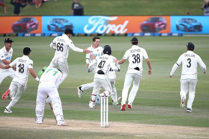 Mitchell Santner celebrates after taking a stunning catch