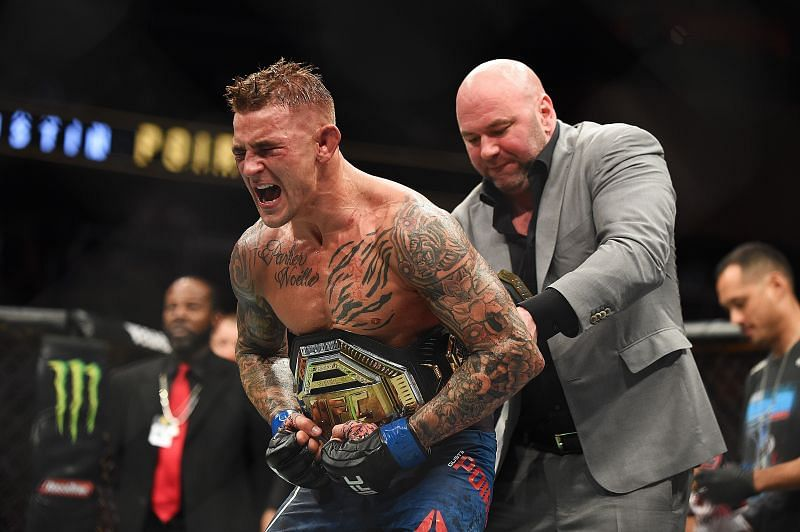 Dustin Poirier celebrates after recieving the title