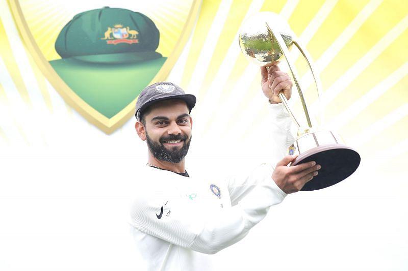 Virat Kohli with the 2018-19 Border-Gavaskar Trophy