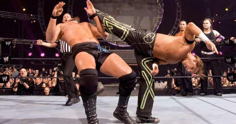 Shawn Michaels delivering the superkick to Mike Knox.