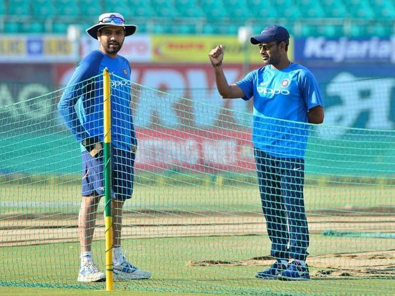 R Sridhar (R) with Rohit Sharma (L) during a fielding session