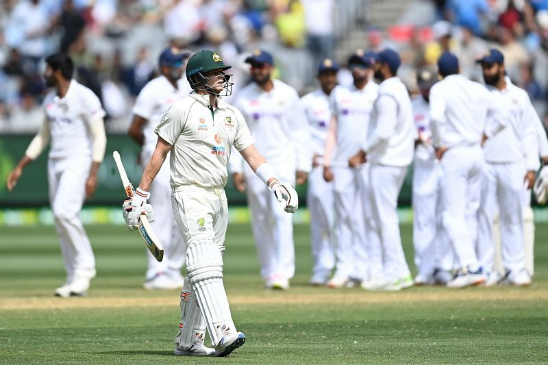 A stunned Steve Smith takes the long walk to the MCG pavilion.
