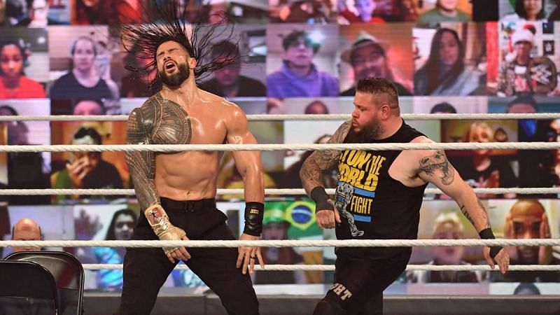 Roman Reigns and Kevin Owens battle each other at TLC