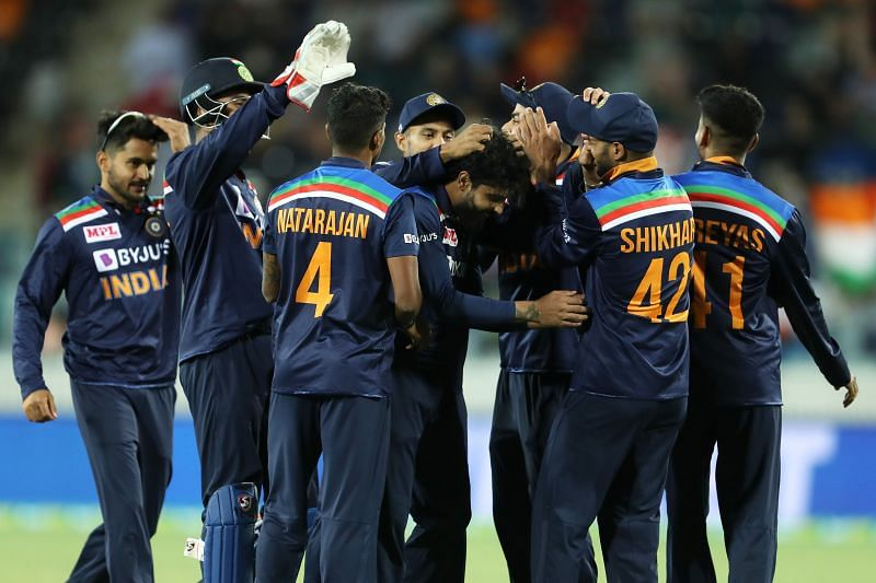 Indian team celebrates after winning the third ODI in Canberra.