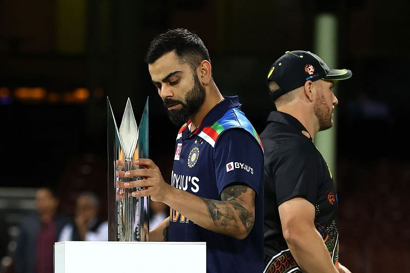 Virat Kohli holds the T20I trophy.