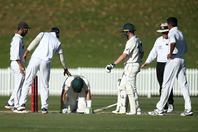Indian cricketers checked on Will Pucovski after he was hit on the helmet