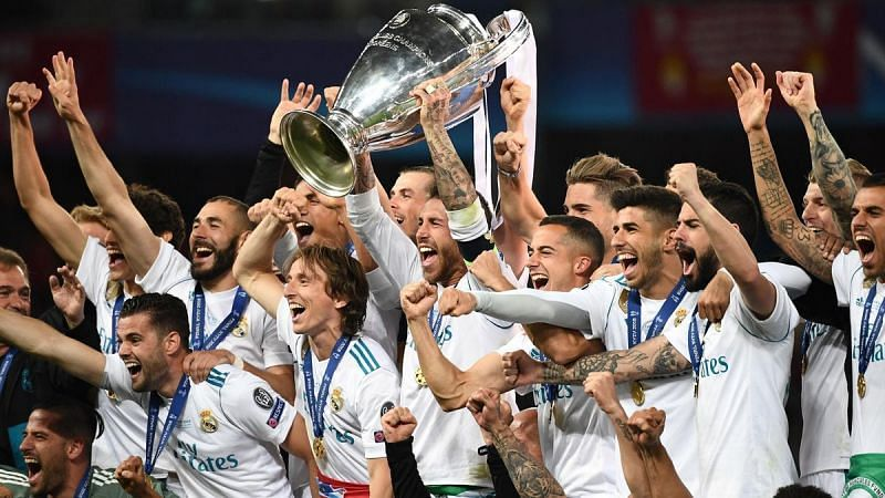Real Madrid players celebrating their 2017/18 UCL win.